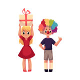 Boy with clown nose and wig, girl holding birthday gift Royalty Free Stock Photos