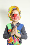 Boy clown with red nose and yellow cap Royalty Free Stock Photos