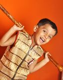 Boy with a club Stock Image