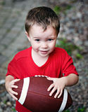 Boy Clutching American Football Royalty Free Stock Images