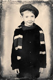 Boy in coat Stock Images