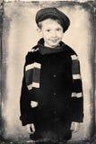 Boy in coat Stock Images