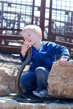 A boy and a cobra Stock Images