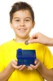 Boy with coin bank Stock Photos