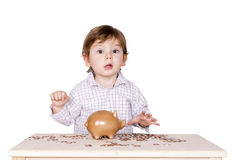 Boy with coins. Royalty Free Stock Image