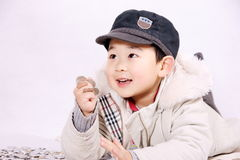 Boy and coins. A picture of a little chinese boy playing happily with coins Stock Photo