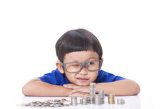 Boy with coins Royalty Free Stock Photos