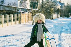Boy on a cold day in a fur hat. Boy on a cold day in a big fur hat Stock Image