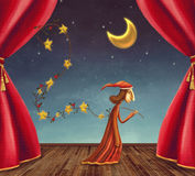 The boy collecting stars on stage Royalty Free Stock Photos