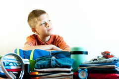 The boy collects his things on the trip stock photo