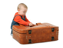 Boy collects luggage Stock Image