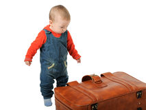 Boy collects luggage Royalty Free Stock Image