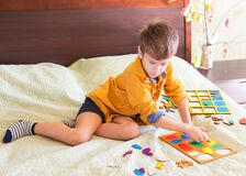 Boy Collects Puzzle In The Form Of Easter Eggs Royalty Free Stock Images