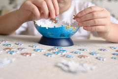 Boy collects puzzles from Globe Royalty Free Stock Photos