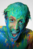 Boy in color. Male model covered in paint Royalty Free Stock Photo