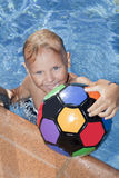 Boy with color ball is  in the swimming pool Royalty Free Stock Photography