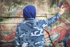 Boy with color spray can Stock Images