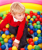 Boy in colored ball. Royalty Free Stock Photos