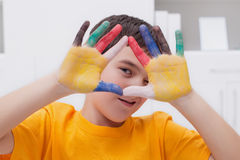 Boy with colored hands Stock Photo