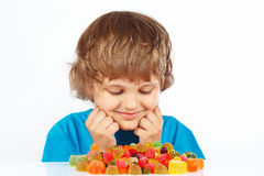 Boy with colored jelly candies on white background Royalty Free Stock Image