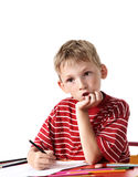 Boy with colored pencils Royalty Free Stock Photos