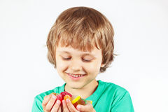 Boy with colored sweets and jelly candies Stock Photos