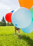 Boy With Colorful Balloons In Park Stock Images