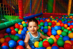 Boy and colorful balls Stock Photography