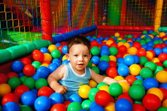 Boy and colorful balls Royalty Free Stock Images