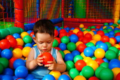 Boy and colorful balls Royalty Free Stock Image