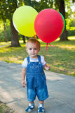 A boy with colorful baloons Stock Photos