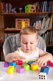 A boy and colorful blocks Royalty Free Stock Image