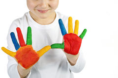 Boy with colorful painted hands Royalty Free Stock Image