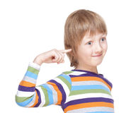 Boy in Colorful Shirt Pointing Finget to his Head Royalty Free Stock Image