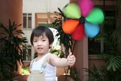 Boy & colorful spinning windmill Stock Photo
