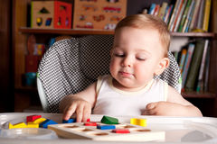 Boy and colorful toy blocks Royalty Free Stock Photo