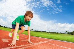 Boy in colorful uniform on the start ready to run Royalty Free Stock Photos