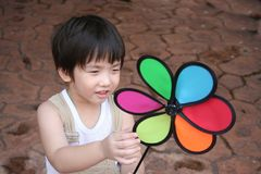Boy & colorful windmill Royalty Free Stock Photography