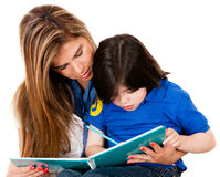 Boy coloring with his mother Royalty Free Stock Images