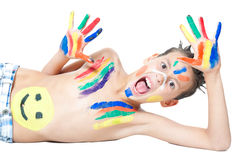 Boy and colors. Boy painting with colors isolated on white Royalty Free Stock Photos