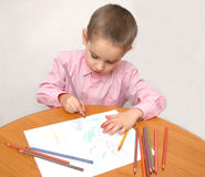 Boy with coloured pencils Royalty Free Stock Photography