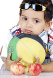 Boy with colourful objects Stock Photography