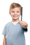 Boy with comb Stock Photo