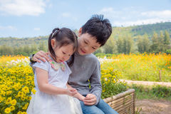 Boy is comforting his crying sister in park Stock Photography