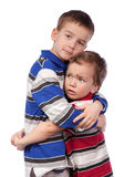 Boy comforts his younger brother Stock Photo