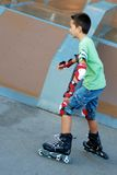 Boy coming down from ramp Royalty Free Stock Image