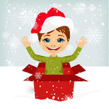 Boy coming out of inside christmas gift box Royalty Free Stock Photos