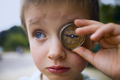 Boy with compass Stock Photography