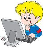 Boy with computer. Little boy sitting at the table and looking at the computer monitor Royalty Free Stock Photography