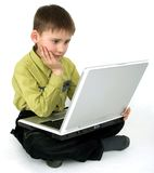 The boy with a computer Royalty Free Stock Photo